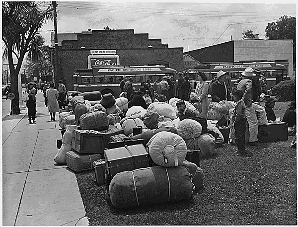 Japanese Americans on their way to the internment camps for enemy aliens