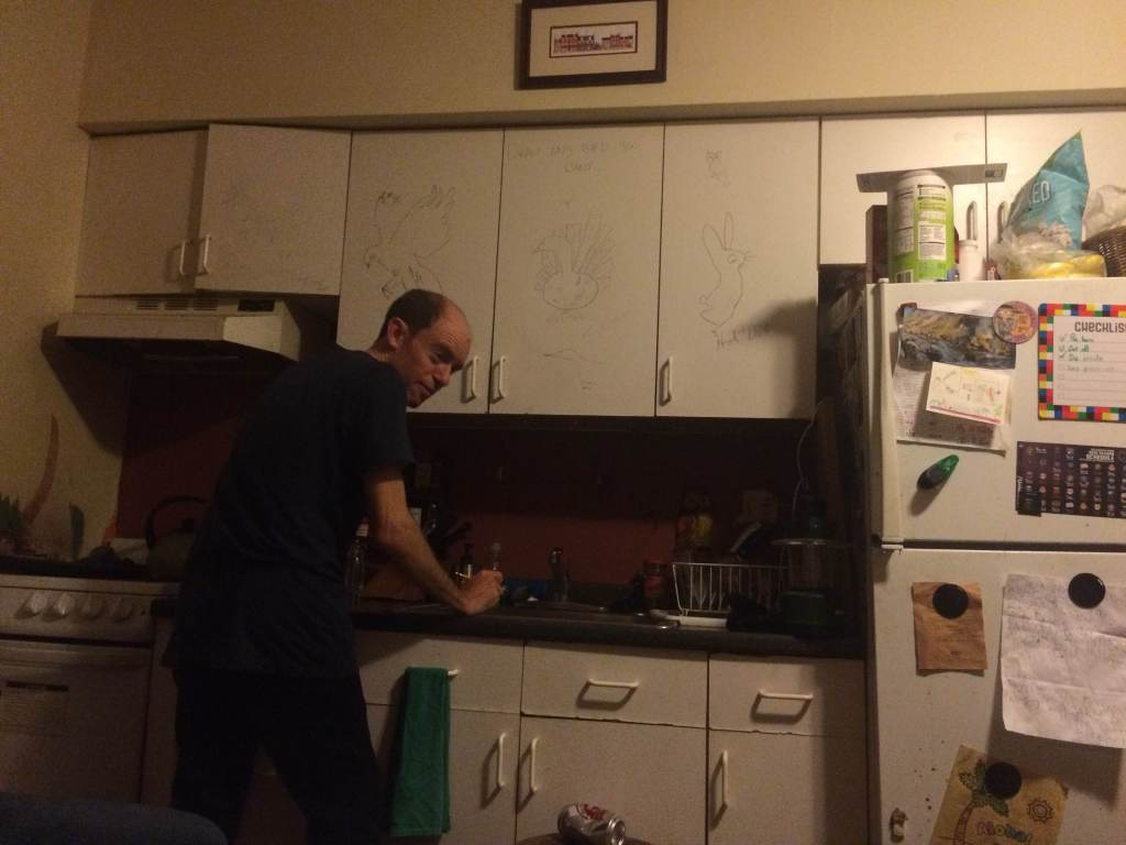 Brian Feldman cleaning the author's dishes. Photo by Hannah Gaudite.