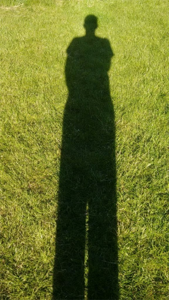 image of shadow for a man stood up