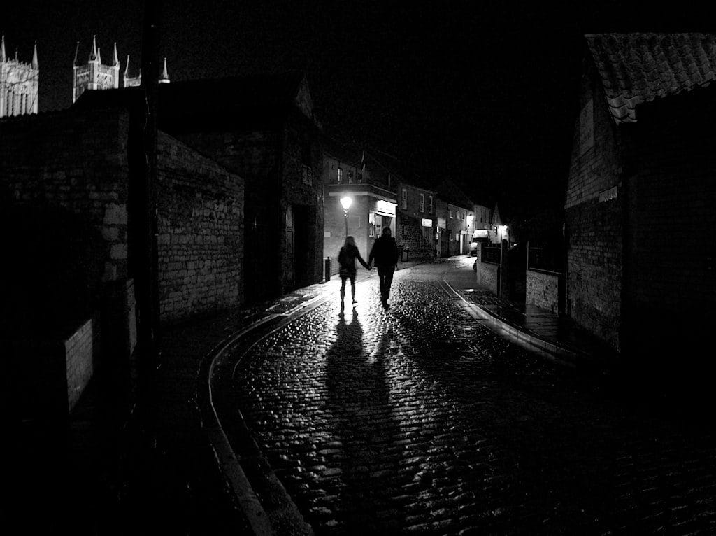 picture of couples shadows in street at night