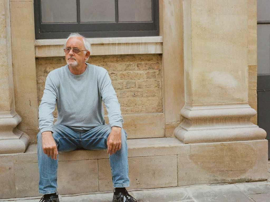 phlogger medium format shot of man posing on streets of lincoln