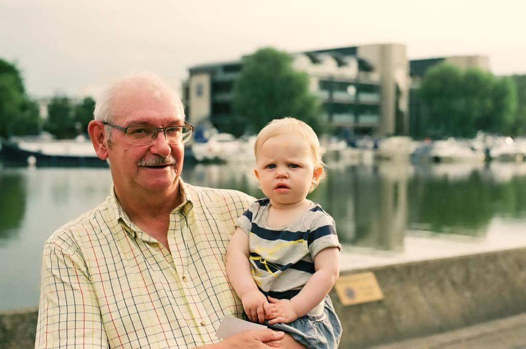 street photography = man with grandchild