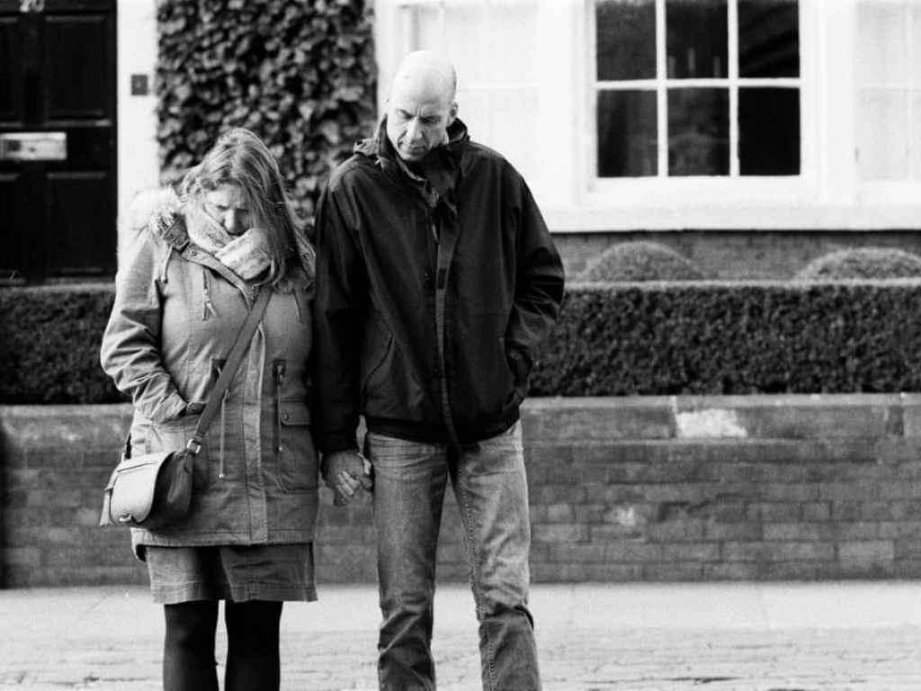 street photo of couple looking down