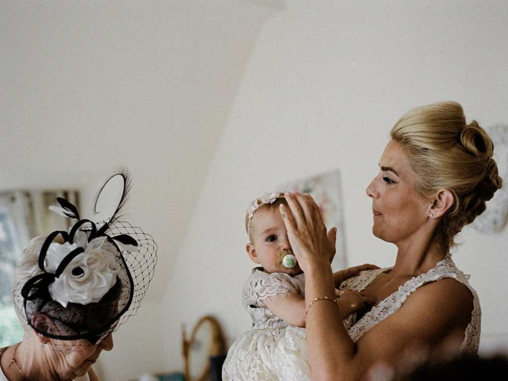 Medium format shot of bride and her daughter