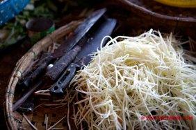 Handgesneden papaya (foto: Pho Vietnam © Kim Le Cao)