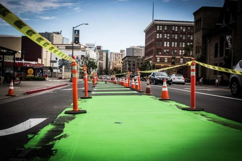 Oakland's new protected bike lane on Telegraph Avenue, under construction in April (Photo by Eugene Chan via Flickr