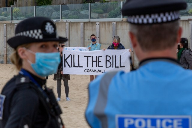 Police on beach in front of a KTB banner