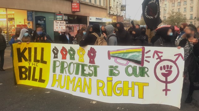 """Protesters holding a banner saying """"Kill the Bill"""" and """"Protest is our Human Right"""" at the MayDay #KillTheBill protest in Bristol"""