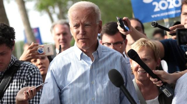 Joe Biden and media microphones