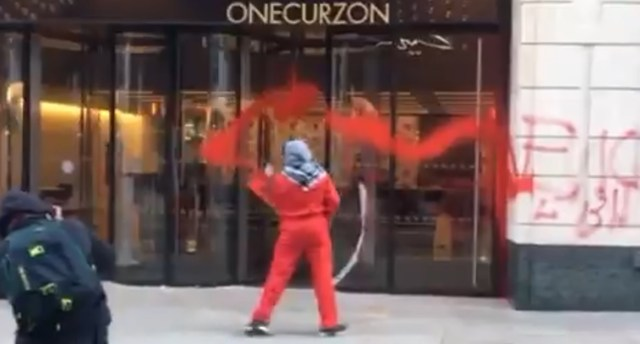 Palestine Action campaigner spraying red paint