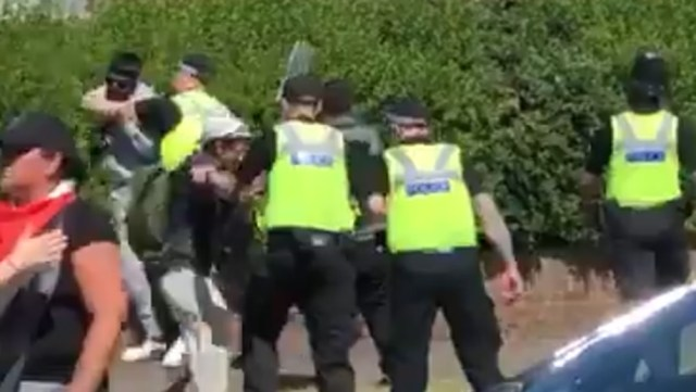 Police officers target protesters in Birmingham