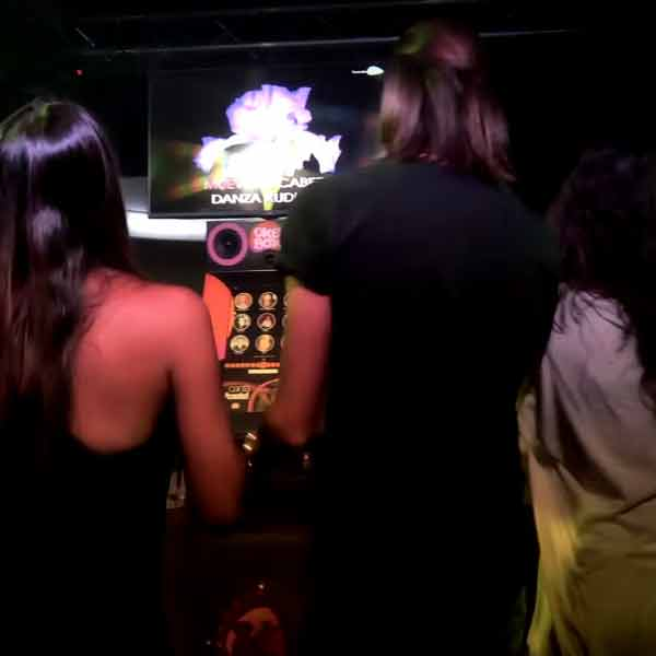 Party with Karaoke Machine with People Singing