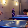 Playing Air Hockey on LED Table at College Event