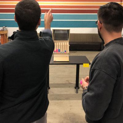 Guys Playing Battle Toss Game Rental