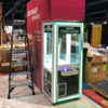 Setting up in tradeshow booth custom claw machine