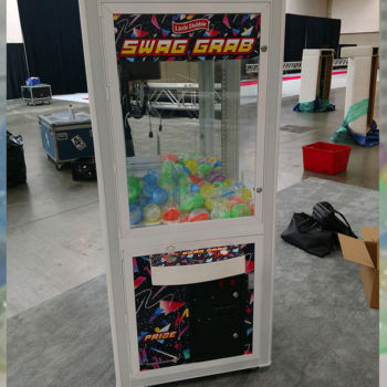 Getting ready for tradeshow with custom claw machine and capsules