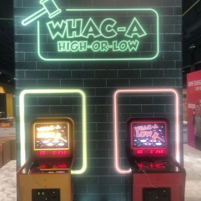 Two custom whack a mole games in trade show booth