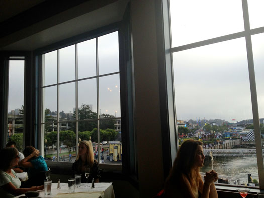 The restaurant's large windows overlooked the chilly, foggy bay.