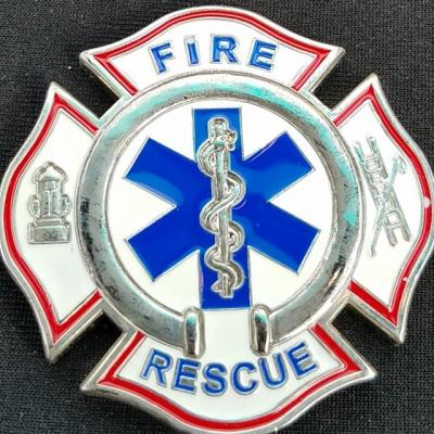 North Prairie Fire Rescue Maltese Cross Shaped Fire Coin from Phoenix Challenge Coins