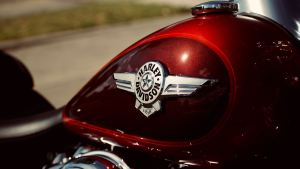 Image of a Harley Davidson logo on a dark red motorcycle gas tank