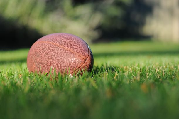 Image of football on grass for the Super Bowl