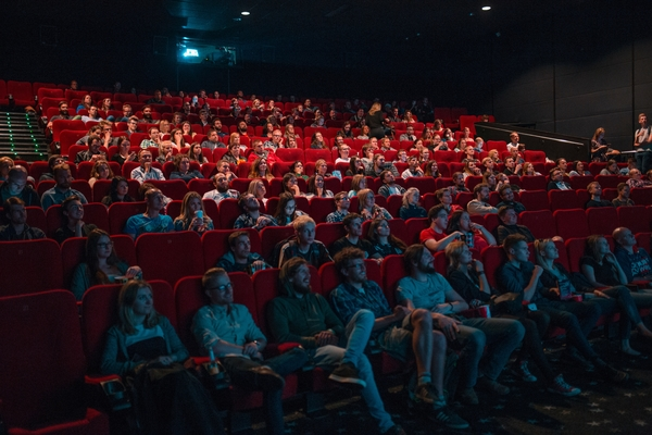 Image of people watching a movie