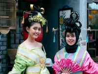 Photo image of two women wearing festive Chinese clothing