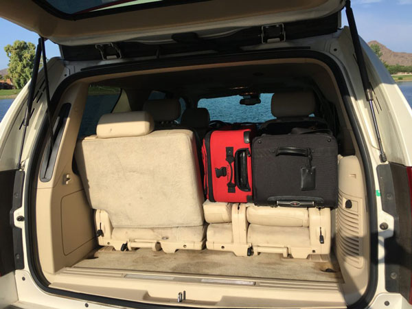Image of Cadillac Escalade Luggage space with one half bench folded