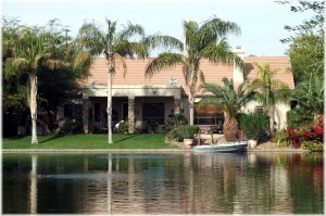 Waterfront on Ocotillo Lakes with boat