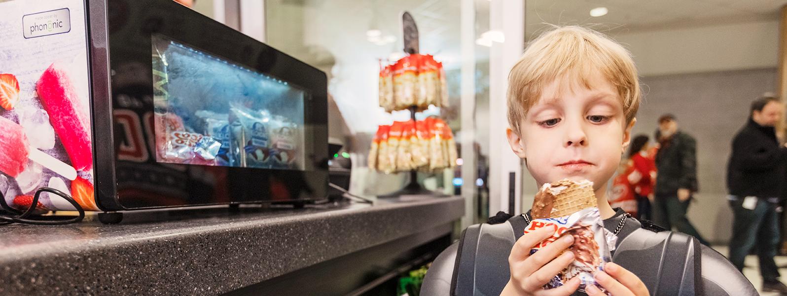 Child eating frozen dessert treat