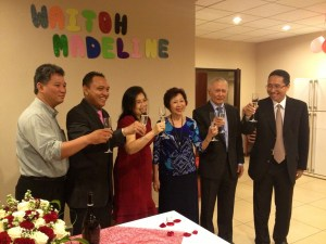 Pastor Jimmy, Pastor Michael and the 2 couples giving a toast