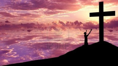13004169-christian-background-silhouette-of-s-man-wroship-the-cross-at-sunset-or-sunrise