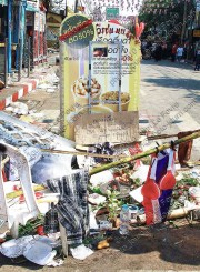 A make-shift shrine to a red-shirt protester killed in clashes with the Thai army at Si Yak Kok Woe in 2010