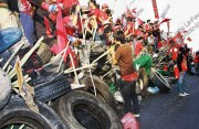 Red-shirt protester atop their bamboo and tire fort on Rama IV Rd. in 2010