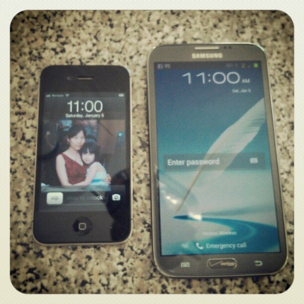 Apple iPhone 4 next to the Note II