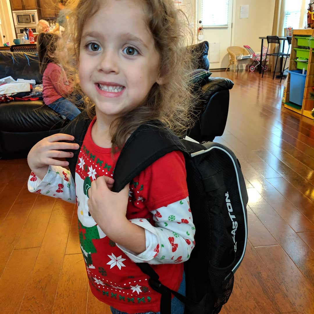 Ana received a baseball bag for Christmas and she's just so excited. Her and Dorothy's tee-ball debut in the spring seems real to her now.