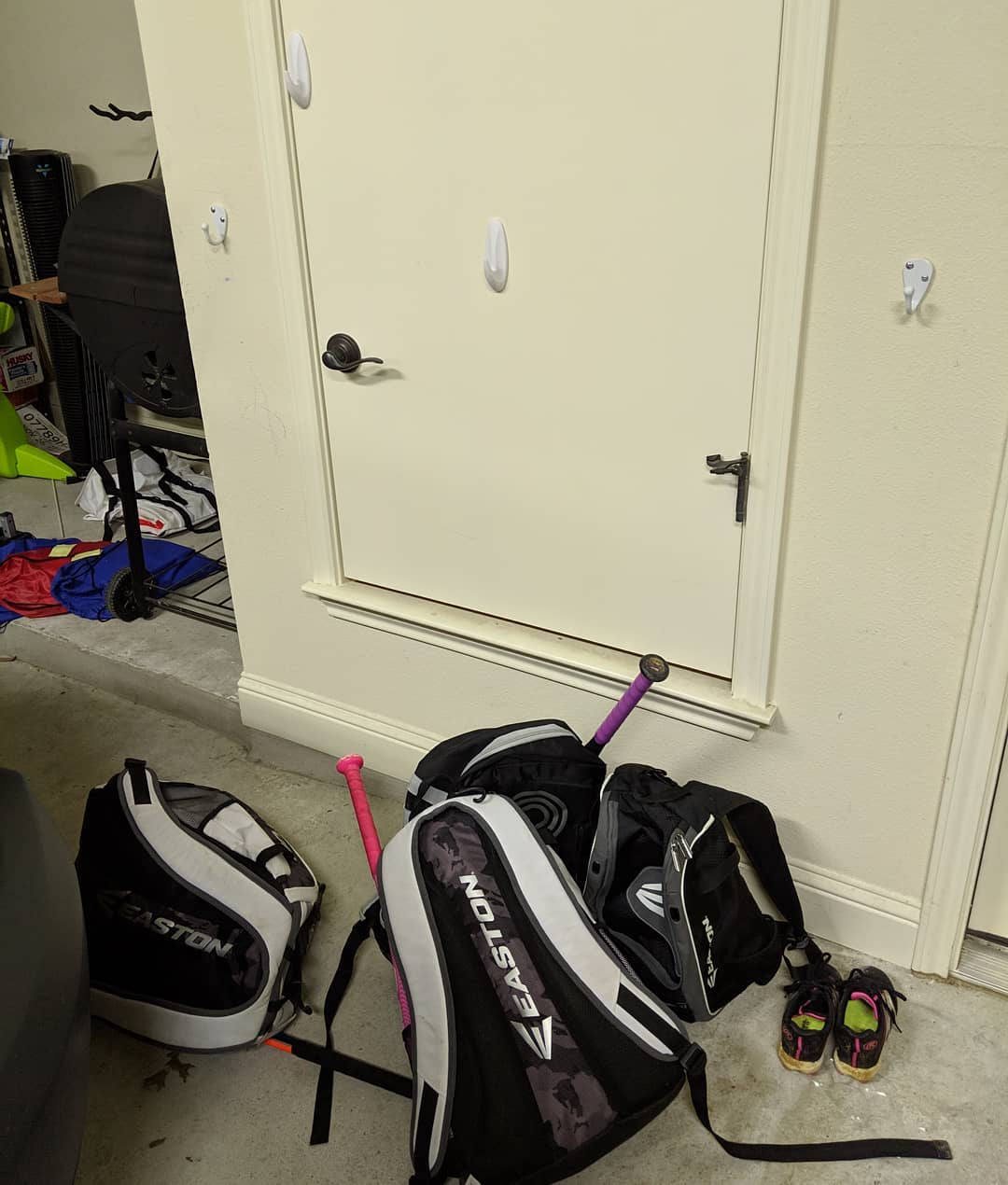 """When you get inside, put your baseball bags away."" I wonder what goes through their minds where putting the bags kinda against the wall *under* the hooks is equal to putting them *on* the hooks"