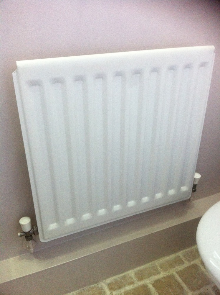 Supply  fit small towel radiator in the cloakroom