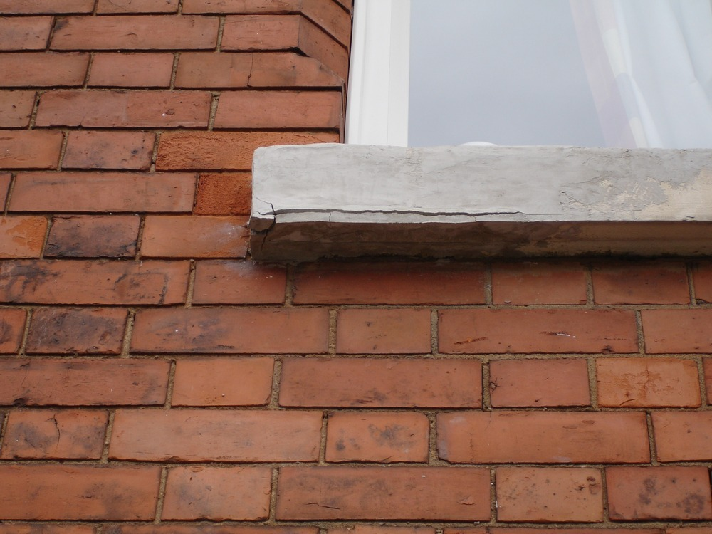 Repair or replace stone windowsill on Victorian house