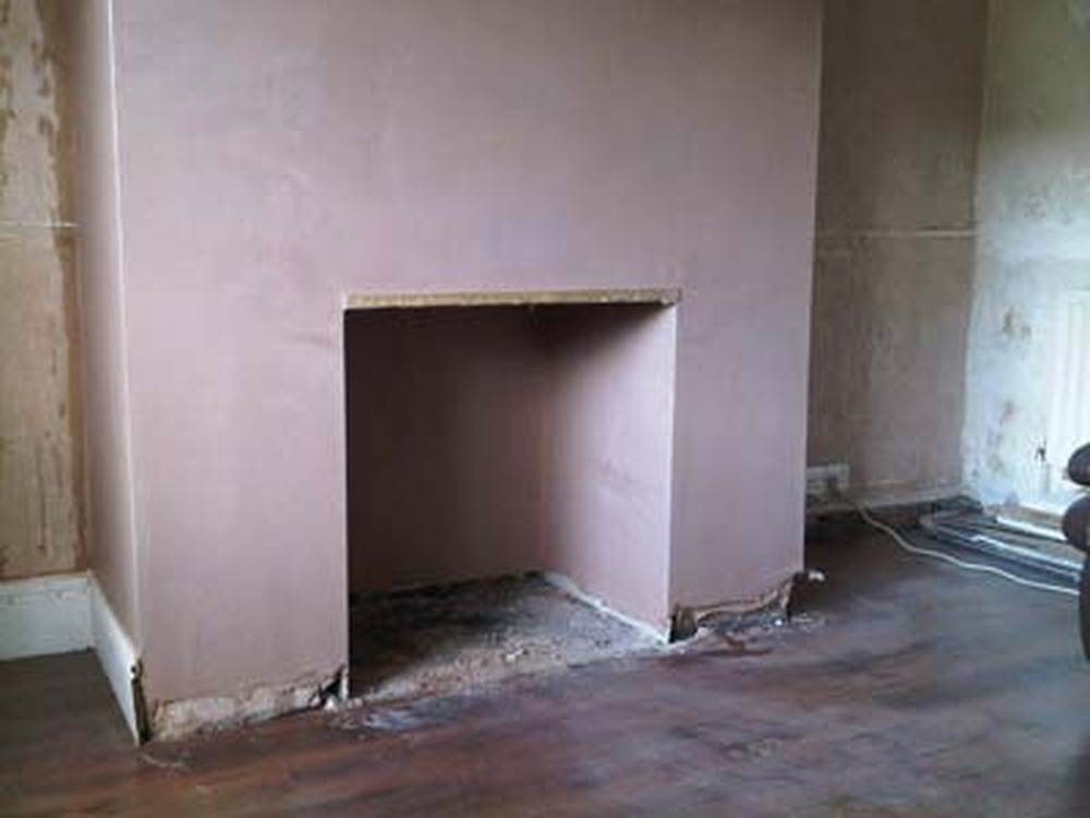 Plaster Stone Clad Fireplace  Plastering job in