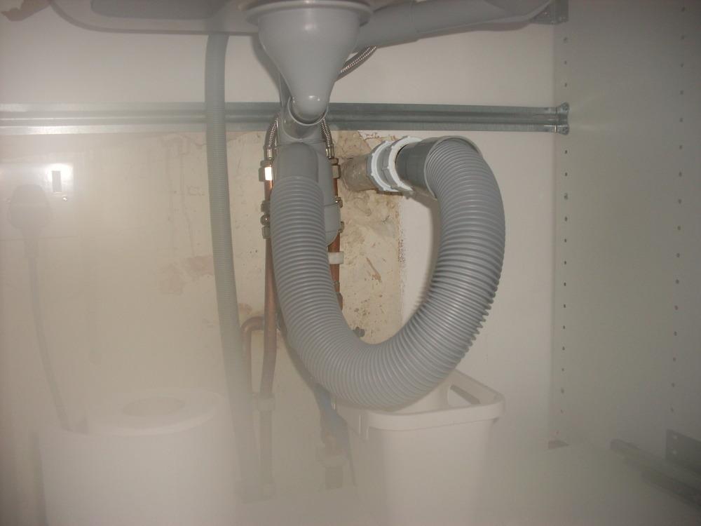 Adjust plumbing under kitchen sink  Plumbing job in