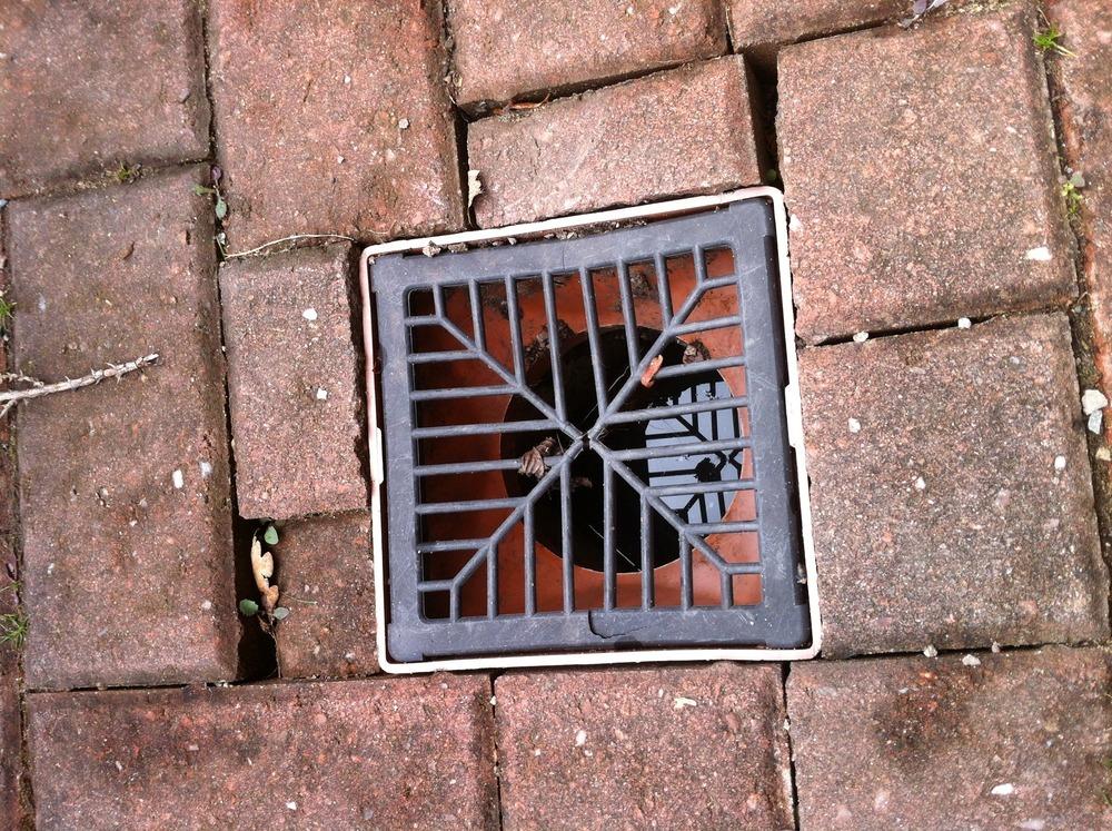 Reset 2 x drain covers on block drive  Driveways job in