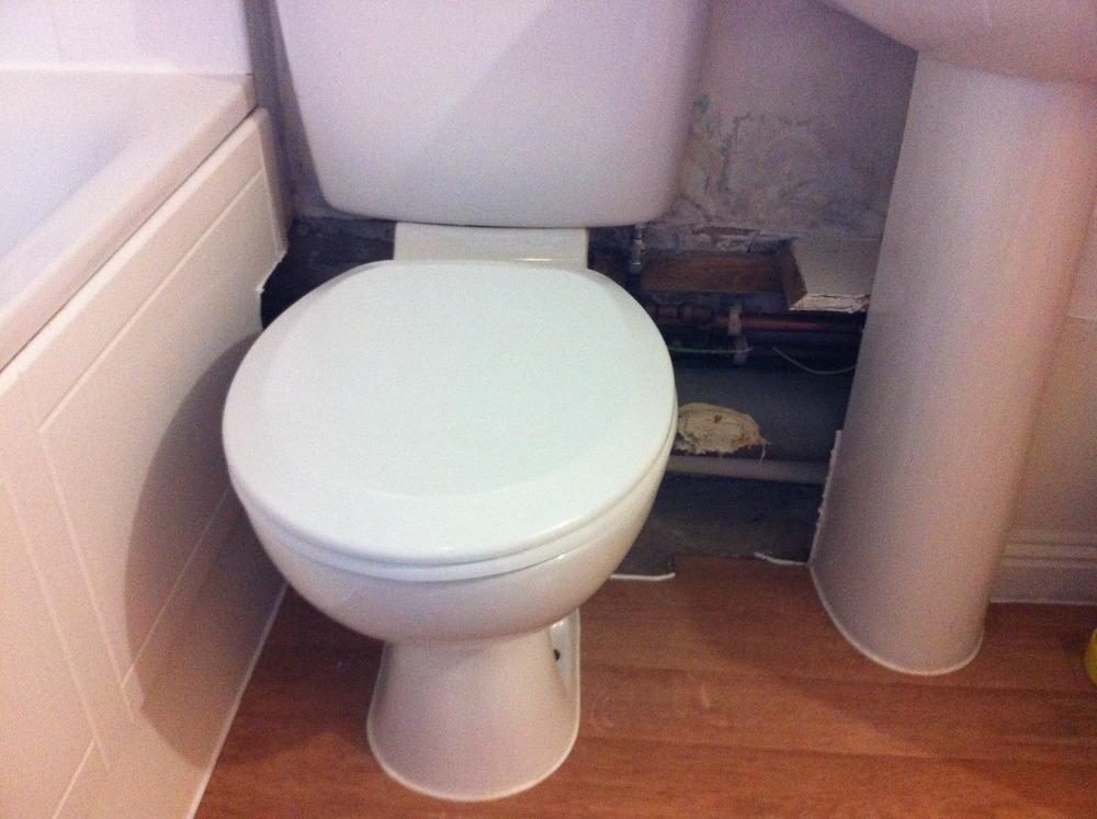 Box work around pipes under toiletsink approx 70cm