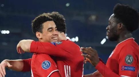Bayern players celebrate with Musaila (Reuters)