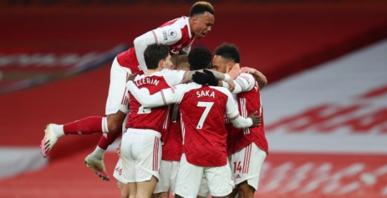 Arsenal players celebrate with Pierre-Emerick Obmiang (Reuters)