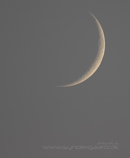 The moon is only a few days old.