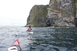 Heading for the bird cliffs in the Atlantic swell. It was a very good experience to be out there in the kayaks.