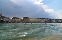 Swimmers in the Rhein as a storm approaches.
