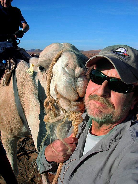 Wilderness Travel guide Mark Gordon and Bob the blond camel in the southeastern part of Morocco.