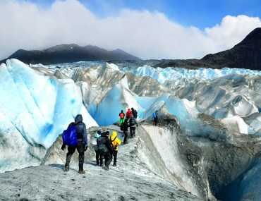 Hikers in crampons trekking on Viedma Glacier in Patagonia